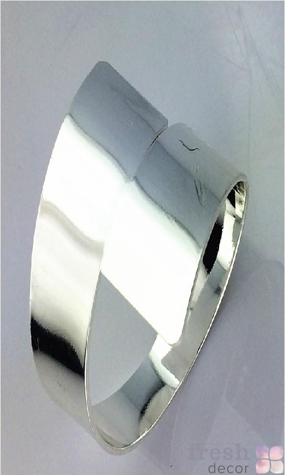 серебняное кольцо для салфеток в виде завитка