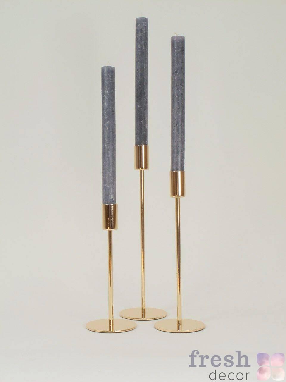 dizajnerskie zolotye podsvechniki dlya odnoj tonkoj svechi na dlinnoj zolotoj nozhke stokgolm